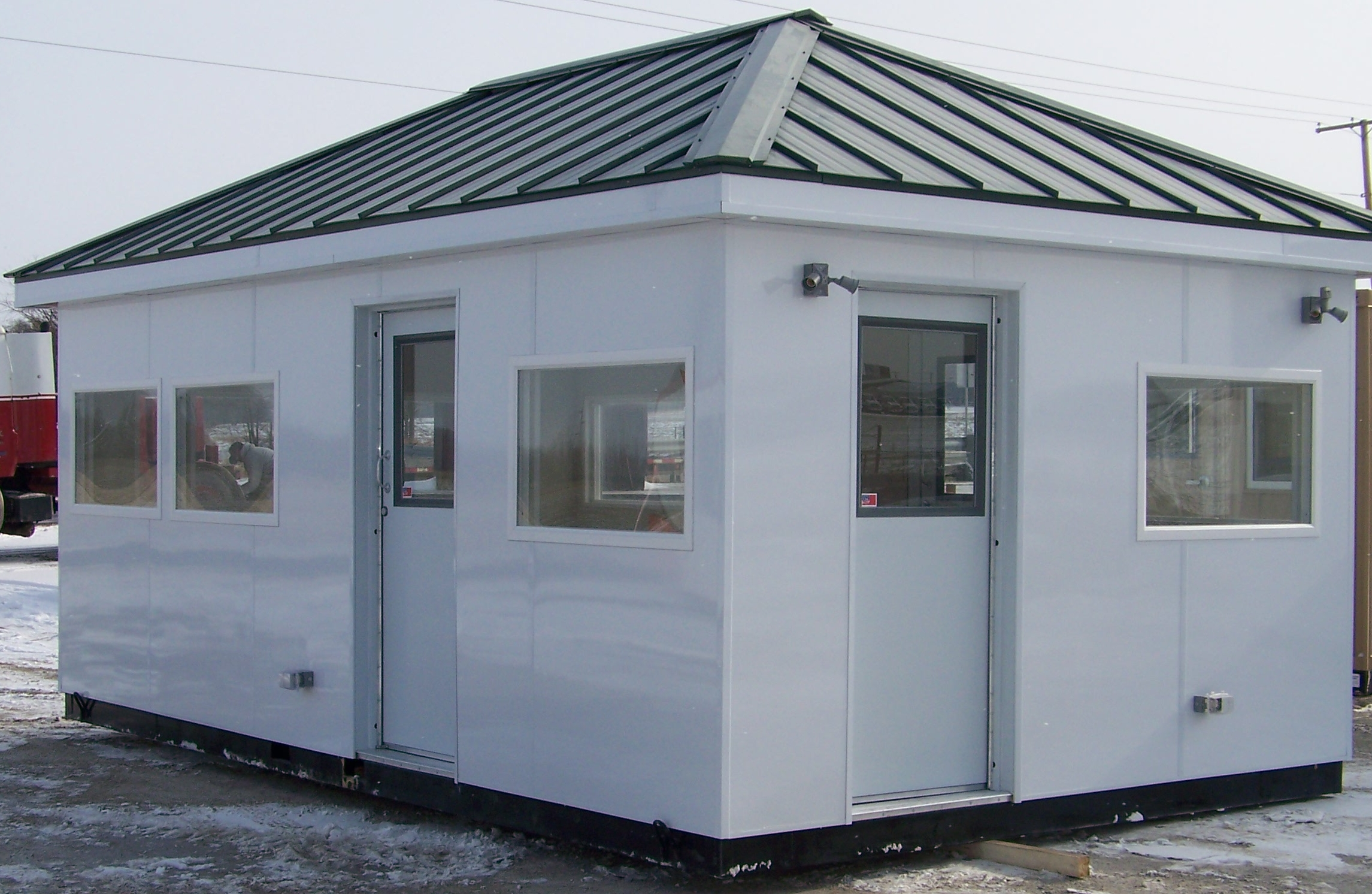 Prefabricated booths guard shacks equipment shelters for Prefab room
